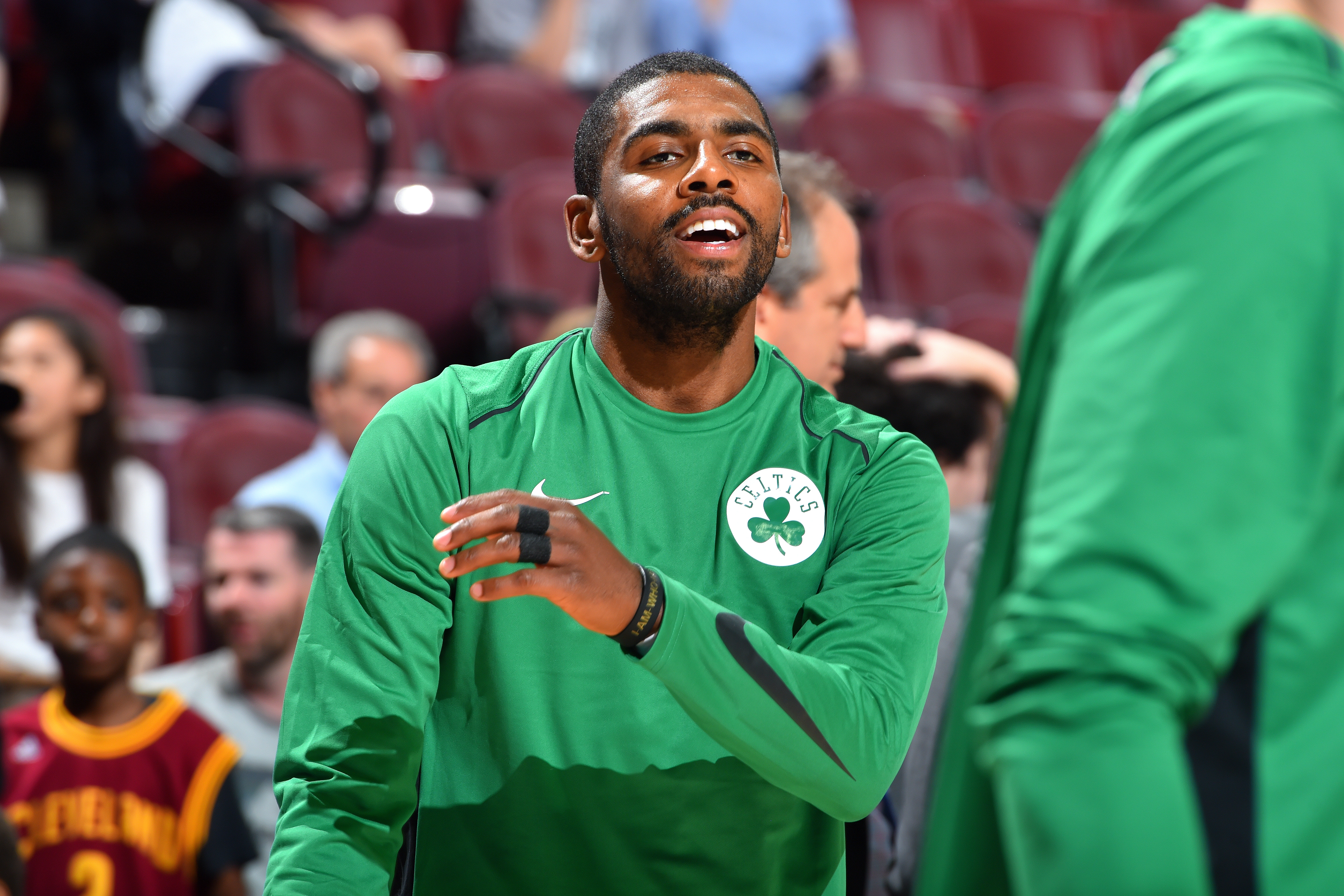Kyrie Irving gives game-worn sneakers to young fan after win