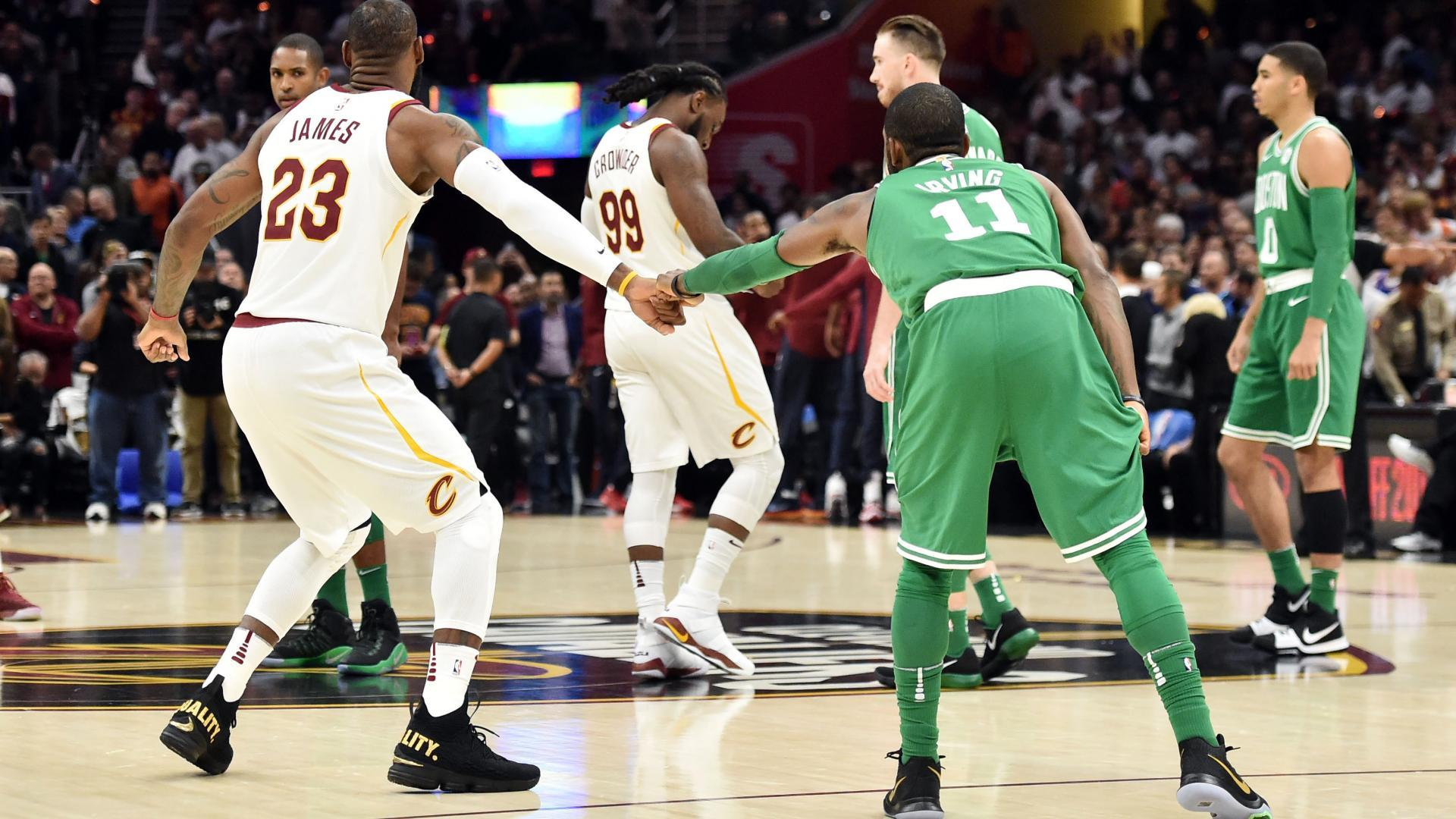 8defcb3e6 Kyrie Irving and LeBron James bump fists before their first 2017-18 game as  opponents.