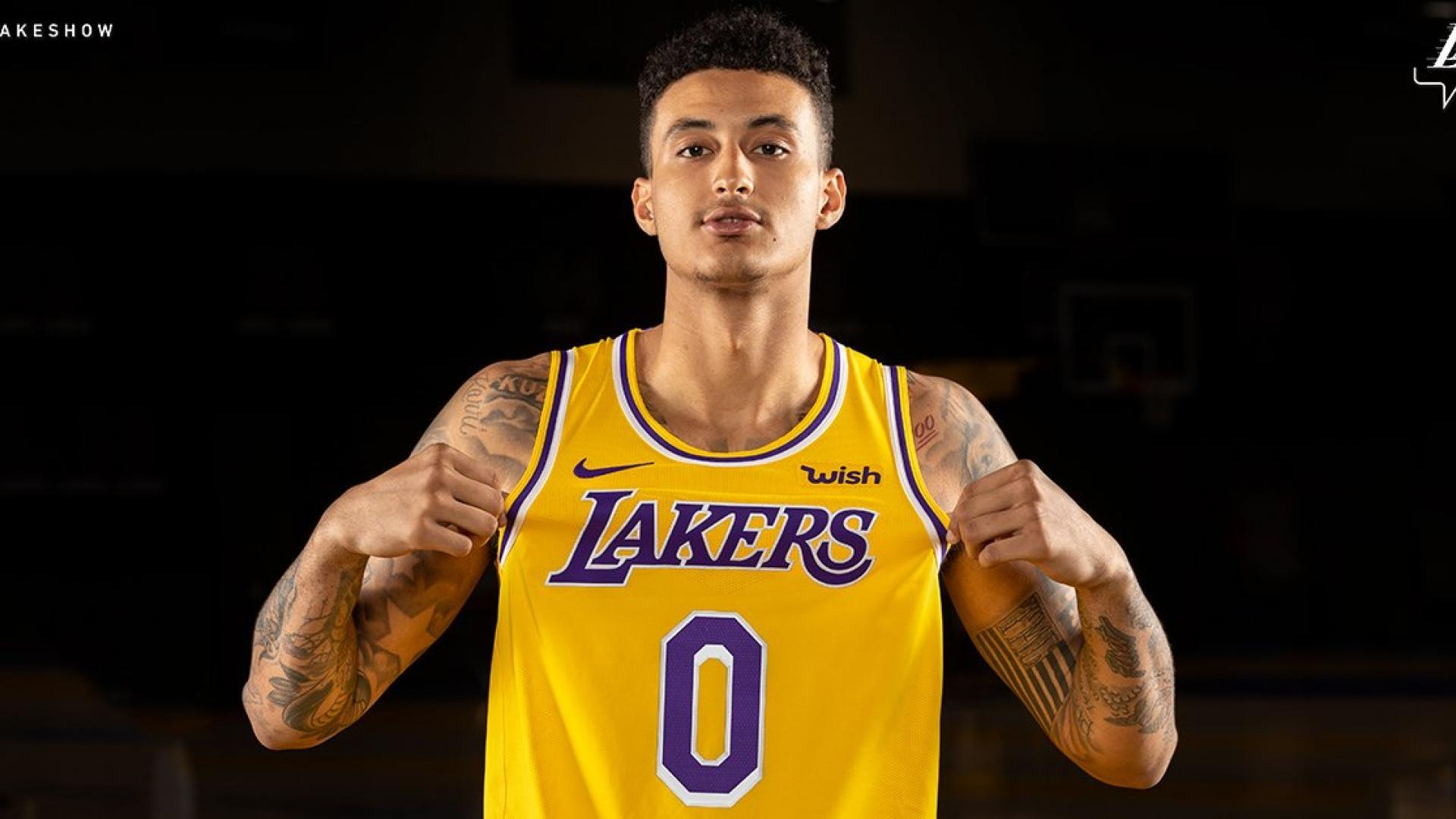Kyle Kuzma shows off the Lakers  Icon edition uniform for 2018-19. 0343484a6