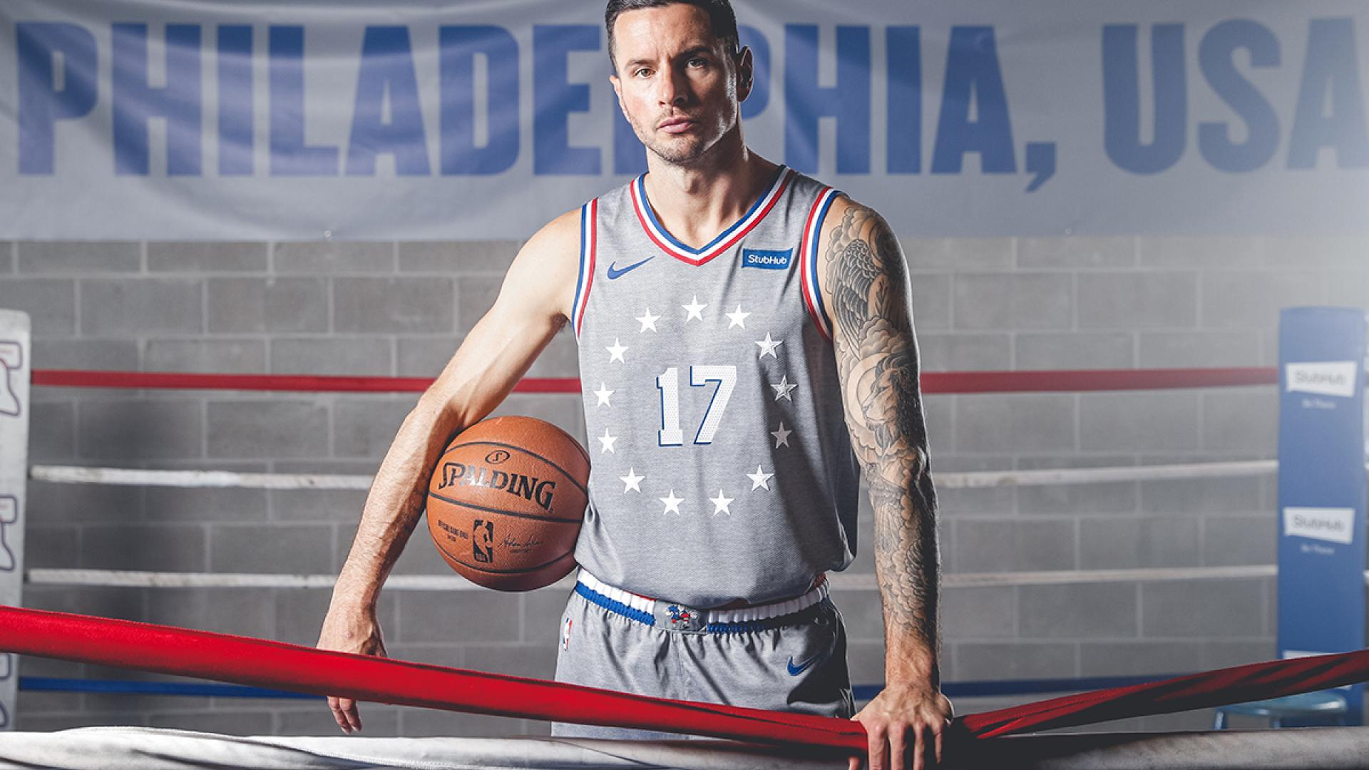 J.J. Redick shows off the team s new City Edition uniforms. dfc48bcfa
