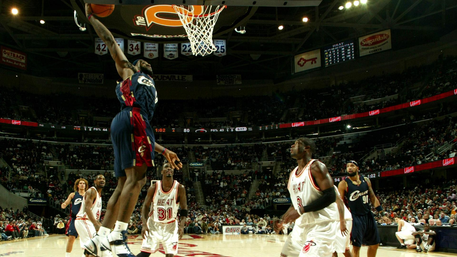 b087a2fa9828 LeBron James elevates for a power jam against the Heat on Dec. 25
