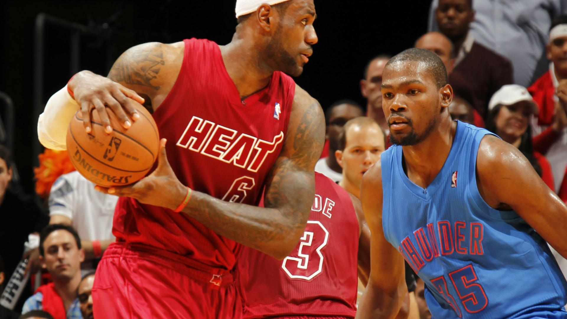 3cc9c0ca0 LeBron James looks to make a move against Kevin Durant on Christmas Day 2012 .